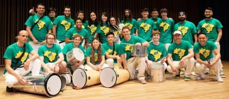 Samba students dressed in Green Shirts with their instruments.